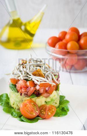 Vegetables and baby eel or elvers tartar