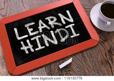 Learn Hindi Handwritten by White Chalk on a Blackboard.