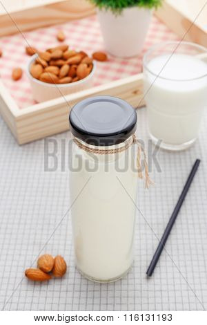 Almond Milk In Glass Bottle With Almonds
