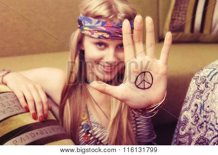 Smiling Hipster Girl Holding Peace Sign And Having Fun.