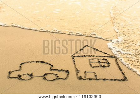House and a Car drawing on the beach sand with the soft wave.