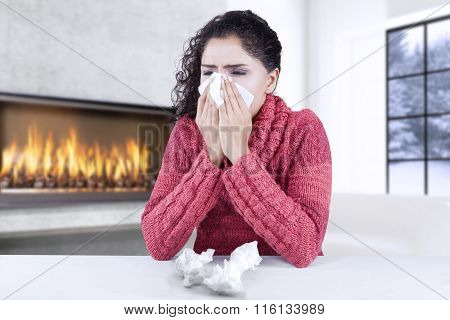 Young Woman Getting Cold And Flu At Home