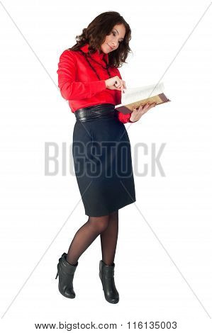 Pretty businesswoman standing with organizer diary