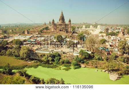 Dirty Green River And Great Hindu Chaturbhuj Temple In Indian City