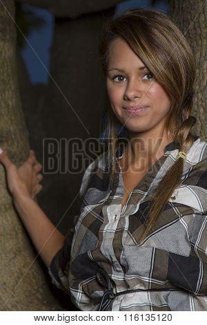 Cute Girl In A Tree