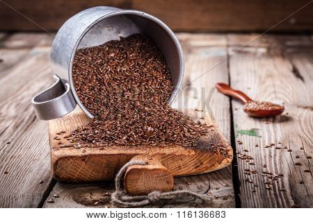 Flax seeds In Bowl On A Wooden Table