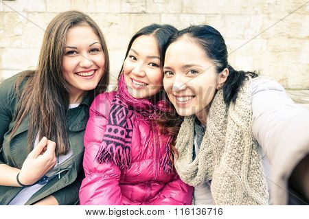Three Beautiful Women Taking Selfie Outdoors - Young Happy Girls On Vacation Having Fun Together