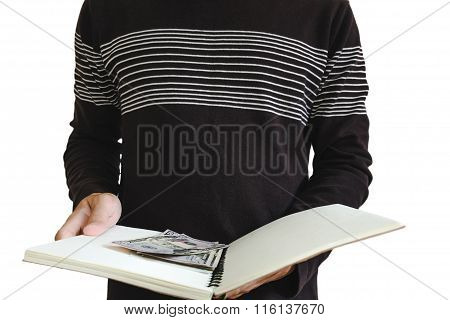 A man opened book with cash hiding inside, selective focus, isolated on white background