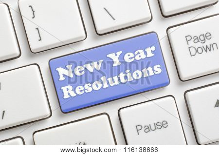 Blue new year resolutions key on keyboard