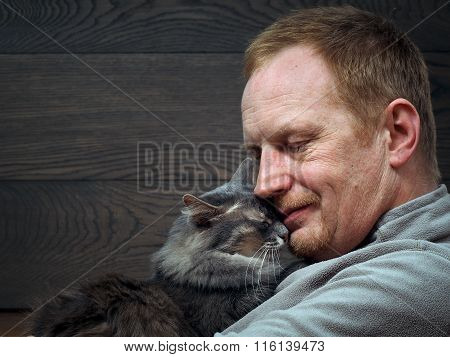 Portrait of a man with a cat