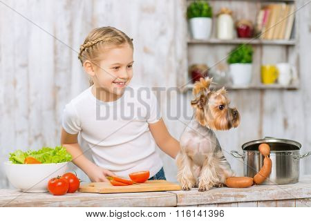 Little girl and her dog on the kitchen table.