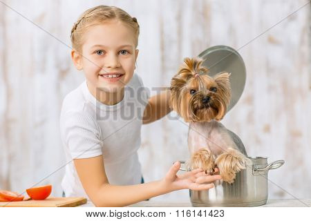 Little girl and her dog in the saucepan.