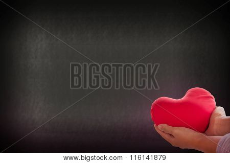 Romantic Lovely Valentine Concept With Hand Gently Raise Up Red Heart On Soft Bokeh Background