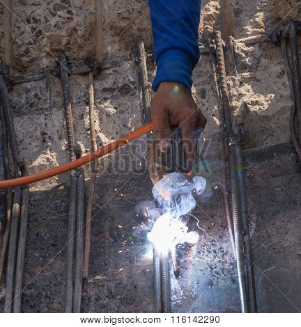 Worker Welding Steel Metal