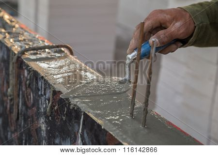 Hand Using Trowel With Wet Concrete