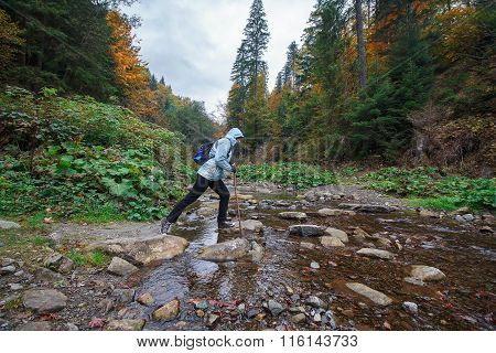 Girl Passes Over Rocks Mountain Stream. Tourism