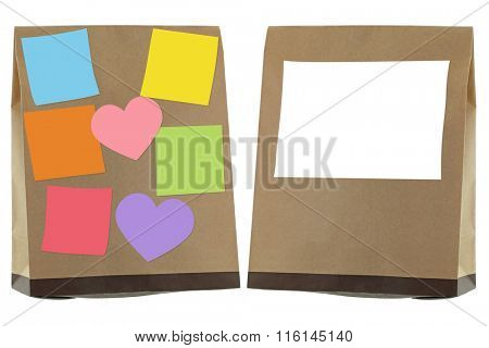 Brown recycled paper bag with blank sticky notes and label on, isolated on white