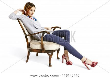 Woman Sitting And Relaxing On An Armchair