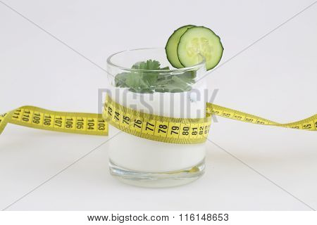 Yoghurt With A Cucumber And Green Parsley And A Measuring Tape