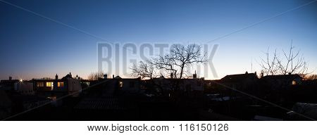 Twilight Over Houses In Village