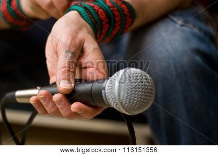 Singer holding a microphone.Rehearsal in the recording studio