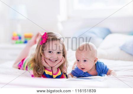 Kids Reading In White Bedroom
