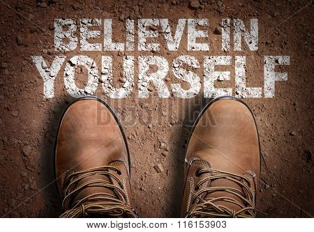 Top View of Boot on the trail with the text: Believe In Yourself