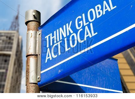 Think Global Act Local written on road sign
