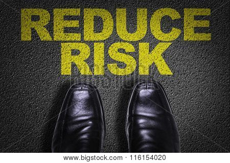 Top View of Business Shoes on the floor with the text: Reduce Risk