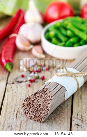 Ingredients for cooking buckwheat noodles with vegetables - dry raw buckwheat noodles, red peppers,