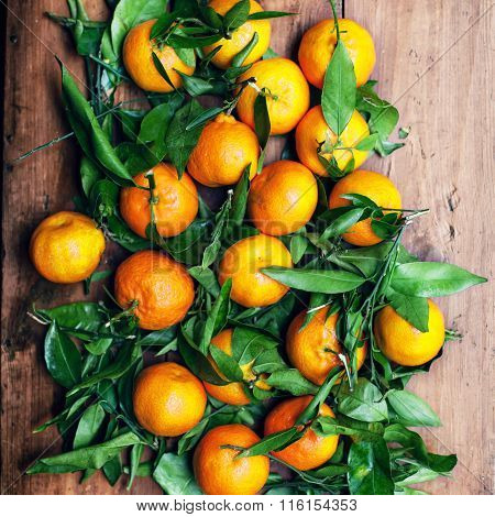 Fresh Picked Mandarines Over Wooden Background