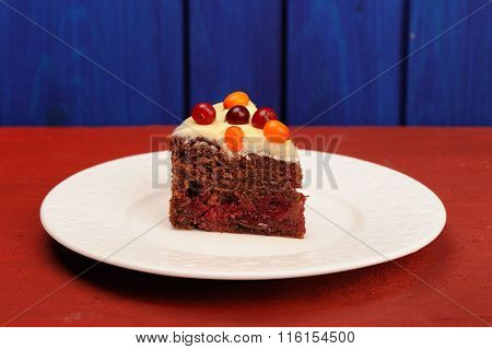 Homemade Chocolate Cake With Icing And Fresh Sea-buckthorn And Cranberries