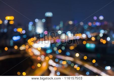 Abstract blurred bokeh lights city motorway intersection night view
