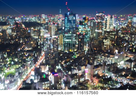 Abstract blurred bokeh light aerial view Tokyo city downtown at night