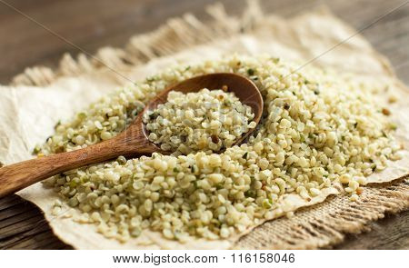 Pile Of Uncooked Hemp Seeds With A Spoon
