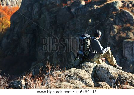 Man sitting on the top of the mountain