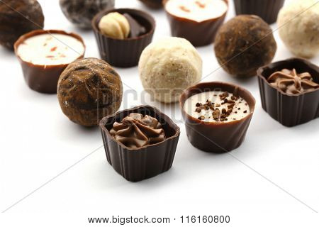 Assorted collection of chocolate candies and sweets, isolated on white, close-up