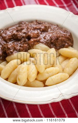 Potato Dumplings With A Sauce Of Beef.