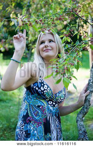 Beautiful fresh spring girl outdoors in a garden