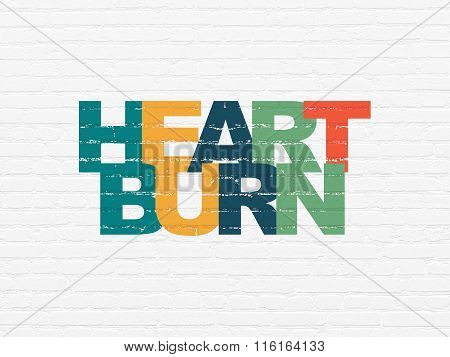 Medicine concept: Heartburn on wall background
