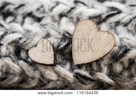 wooden hearts symbol of love, in knitted woolen scarf