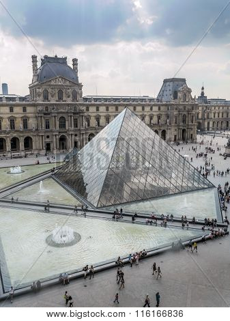 PARIS, FRANCE - AUGUST 28 2013: - The main courtyard of the Louvre Museum with the glass Pyramid
