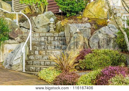 A nice entrance of a luxury house with outdoor landscape