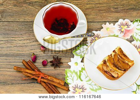 Apple Pie with Tea Cup on Woody Backfround