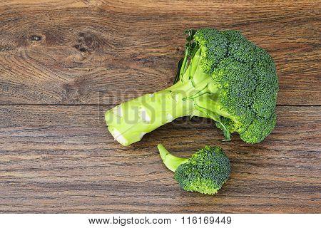 Fresh Juicy Green Broccoli on Wood Background