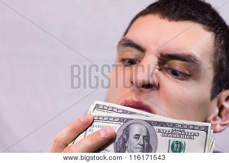 Man sniffing dollars