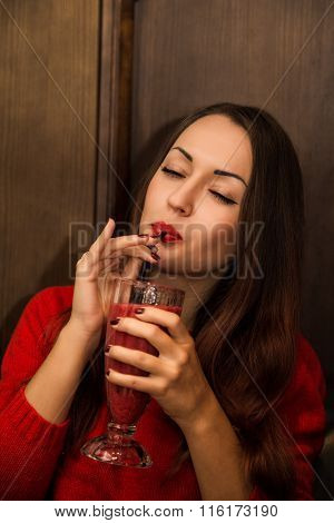 Young and beautiful ukrainian girl  is sexy  drinking red smoothie cocktail