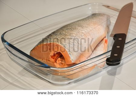 Purified Fish For Cooking In A Glass Tray And Knife