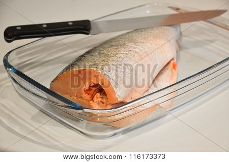 Fish For Cooking In A Glass Tray And Knife