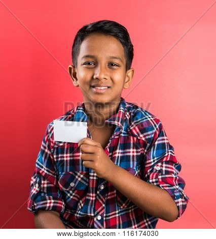 indian kid holding white card, indian boy and card, indian kid or indian boy with white card or bann
